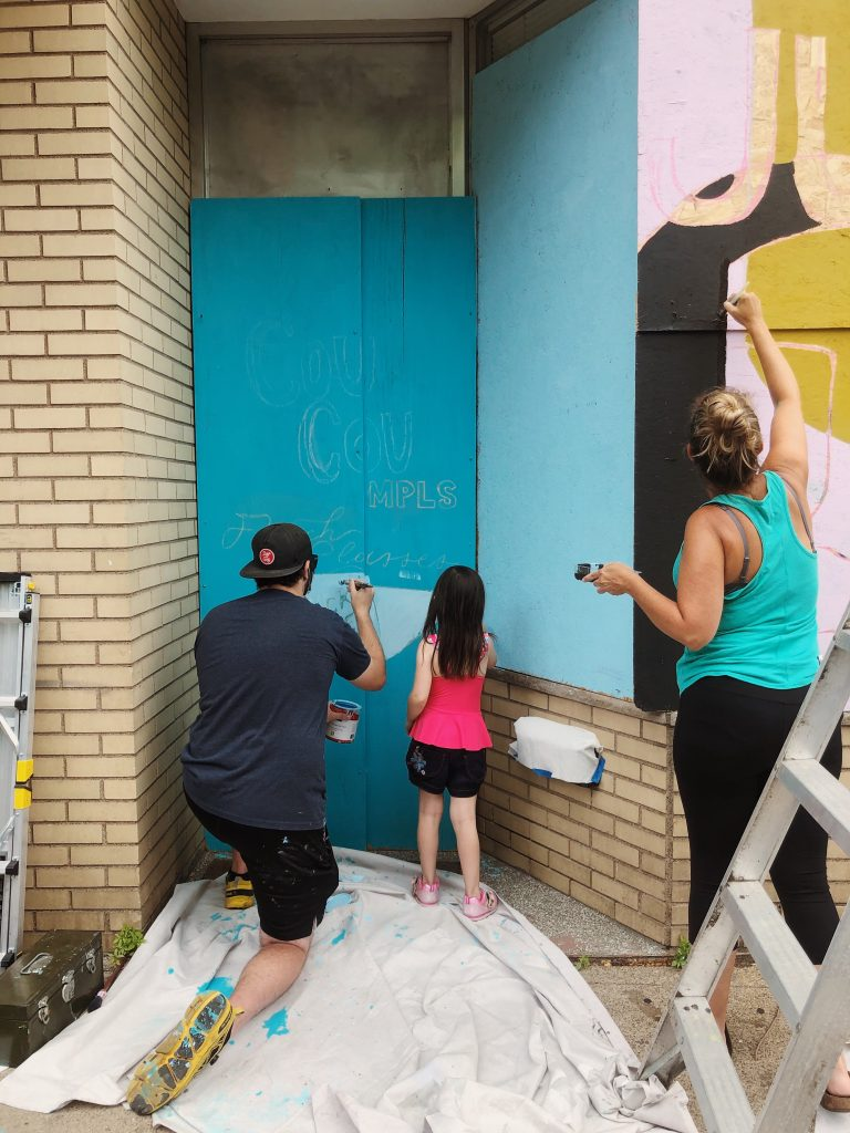 Artists working on murals in Minneapolis
