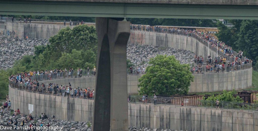 Protestors line highway walls