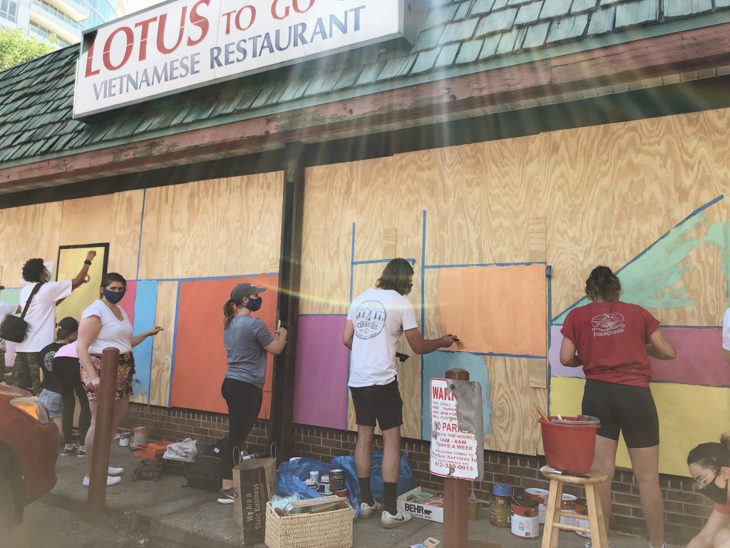artists painting mural at Lotus Restaurant i