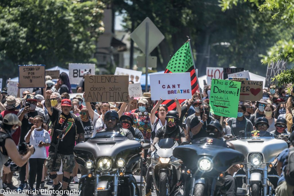 Protestors march led by motorcyclists