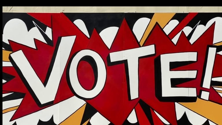 "Mural with exciting and colorful text spelling ""VOTE"" on wall in Princeton"