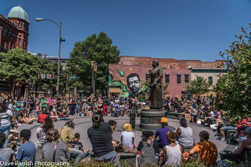 Crowd gathered around Maggie L. Walker statue in Richmond