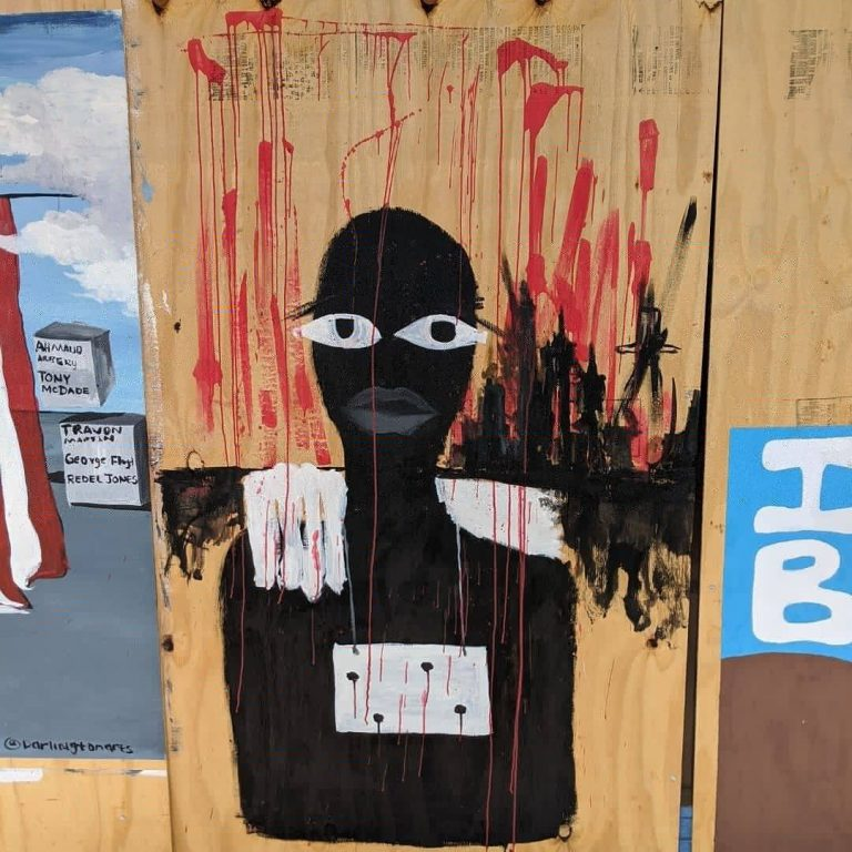 detail of Sota Letters Co mural art of black female figure with bullet holes in chest