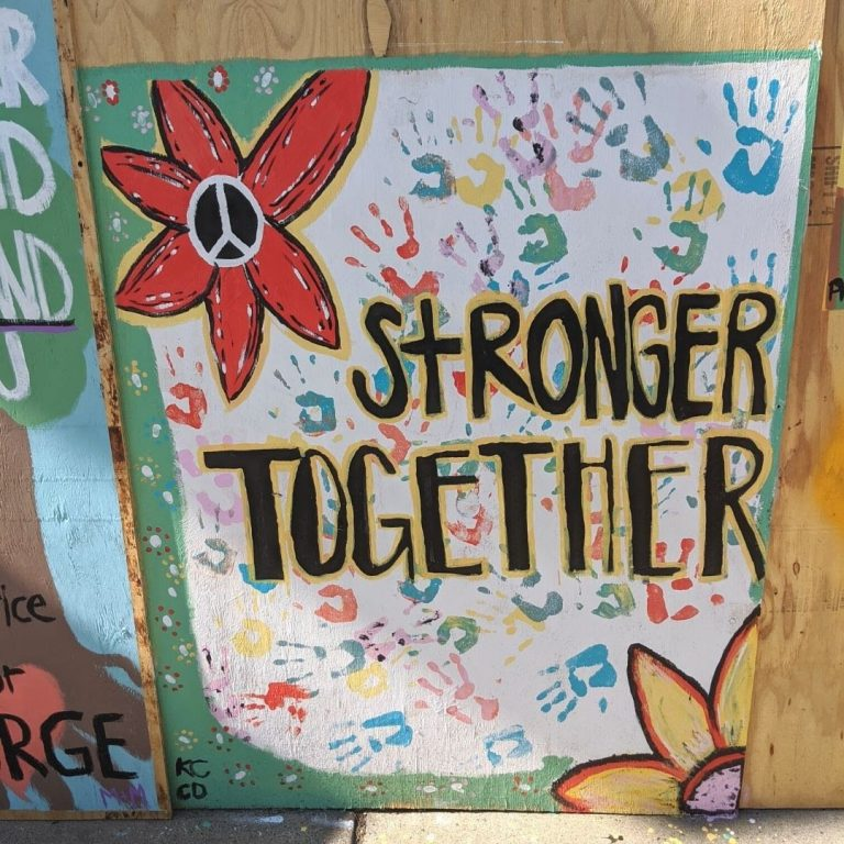 "detail of Sota Letters Co mural art flower with ""Stronger Together"" text"