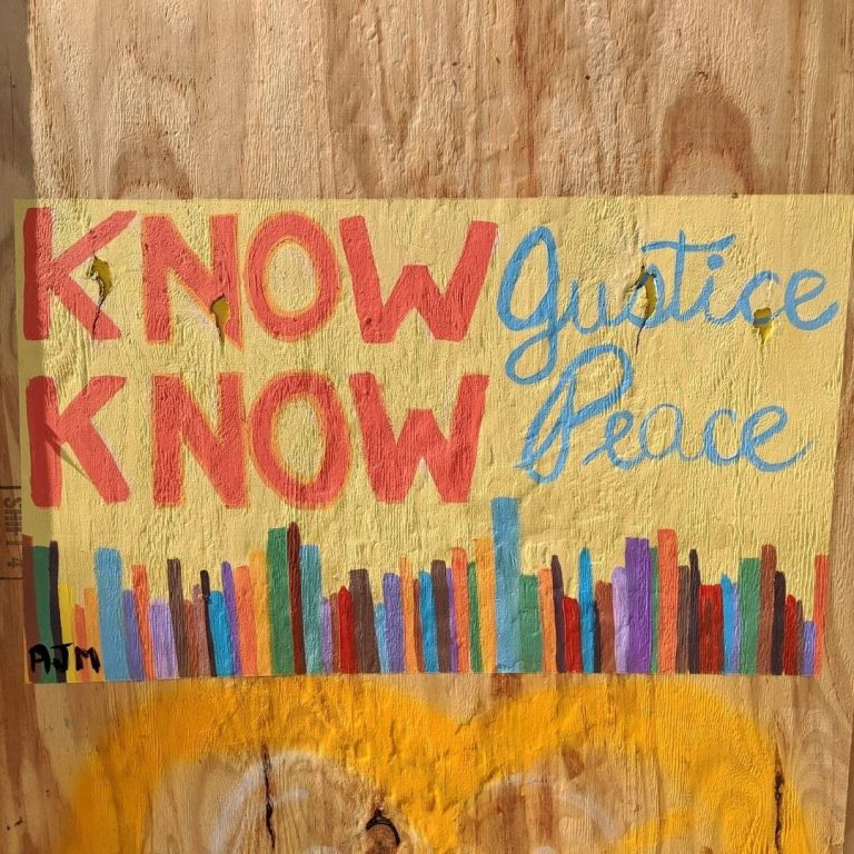 Sota Letters Co. mural of colorful row of books below text Know Know Justice Peace