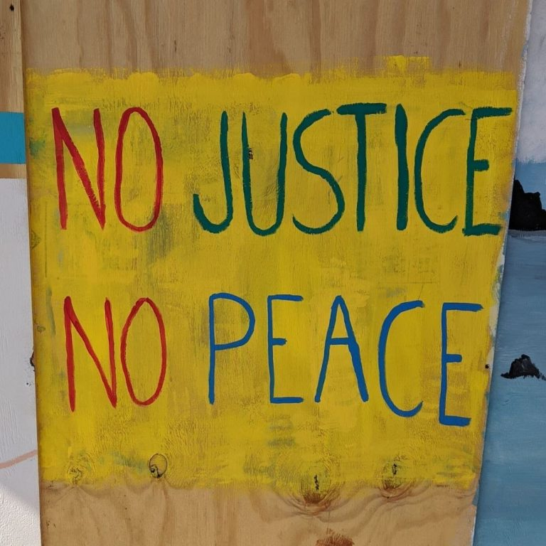 "Sota Letters Co. mural text ""No Justice No Peace""."
