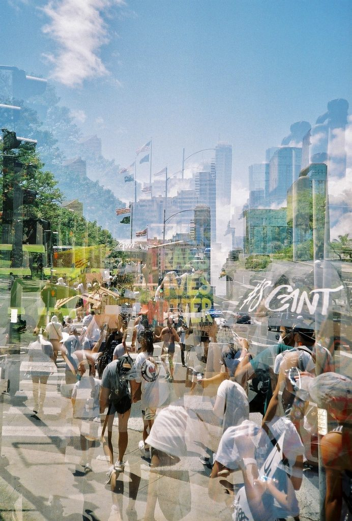 Double exposure of people at protest in Honolulu