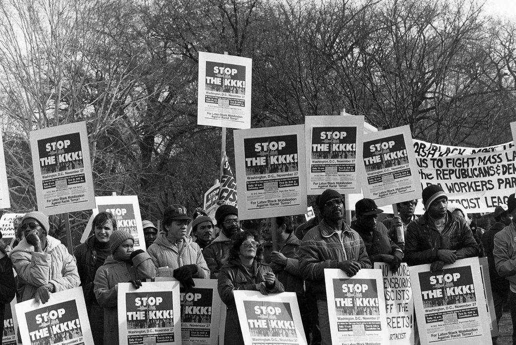 Protestors with Stop the KKK signs