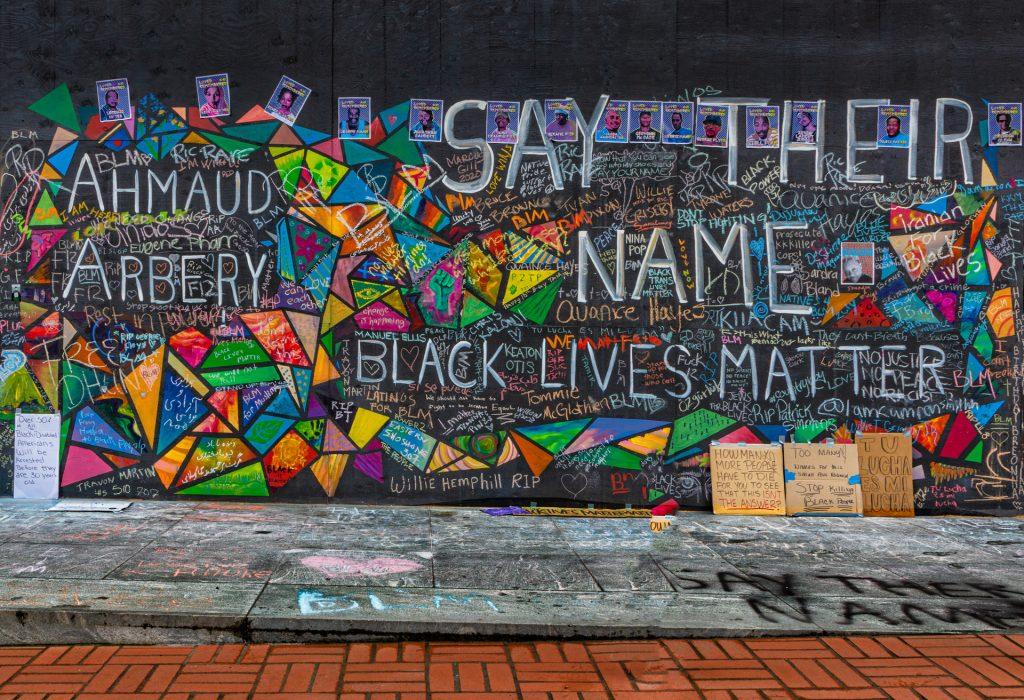 Mural in downtown Portland, OR with text reading Armaud Arbery, Black Lives Matter and Say Their Name