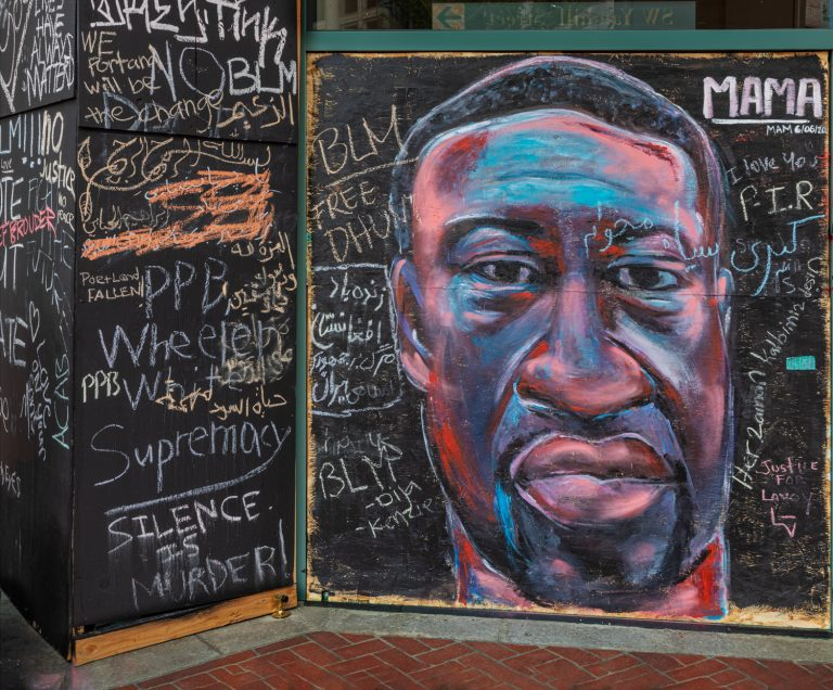 Mural in downtown Portland, OR of George Floyd with Silence Is Murder among writing on mural.