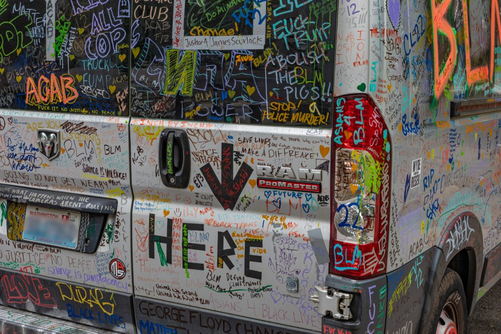Colorful graffiti art on van parked in downtown Portland, OR