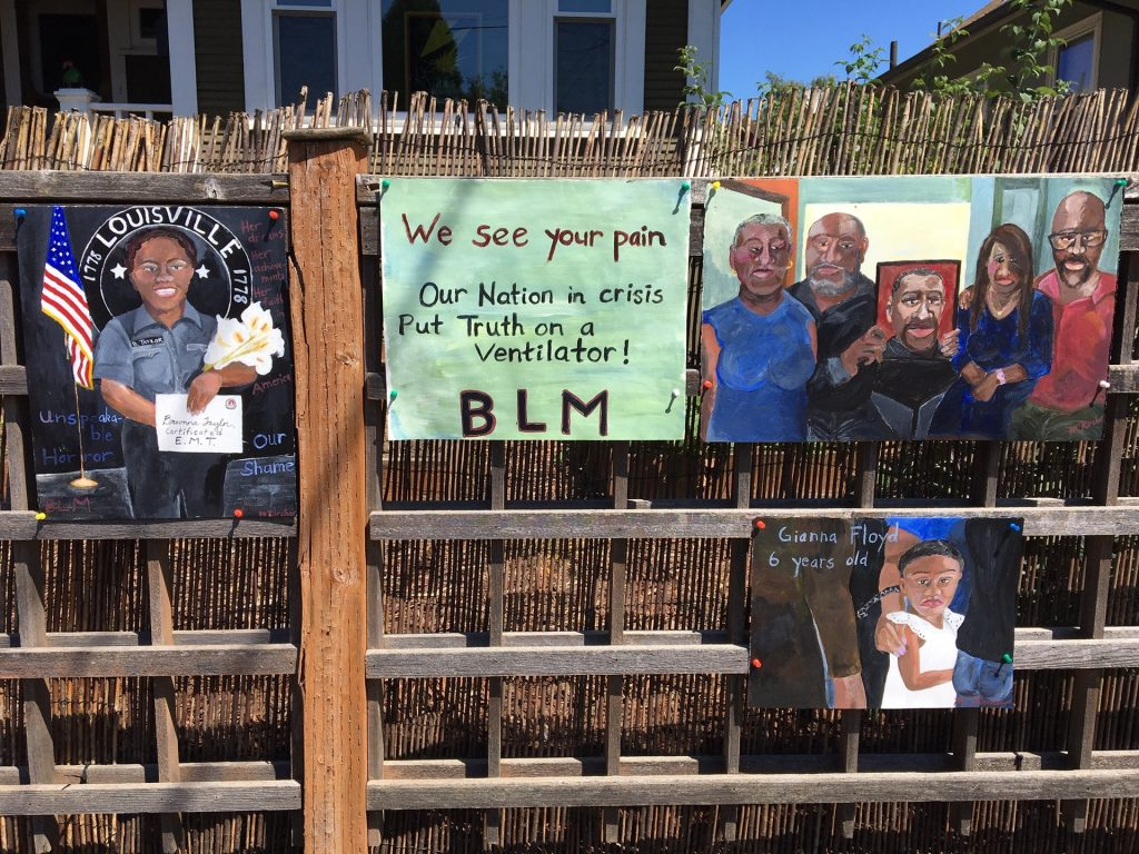 Pieces hung on a fence summer 2020 blm