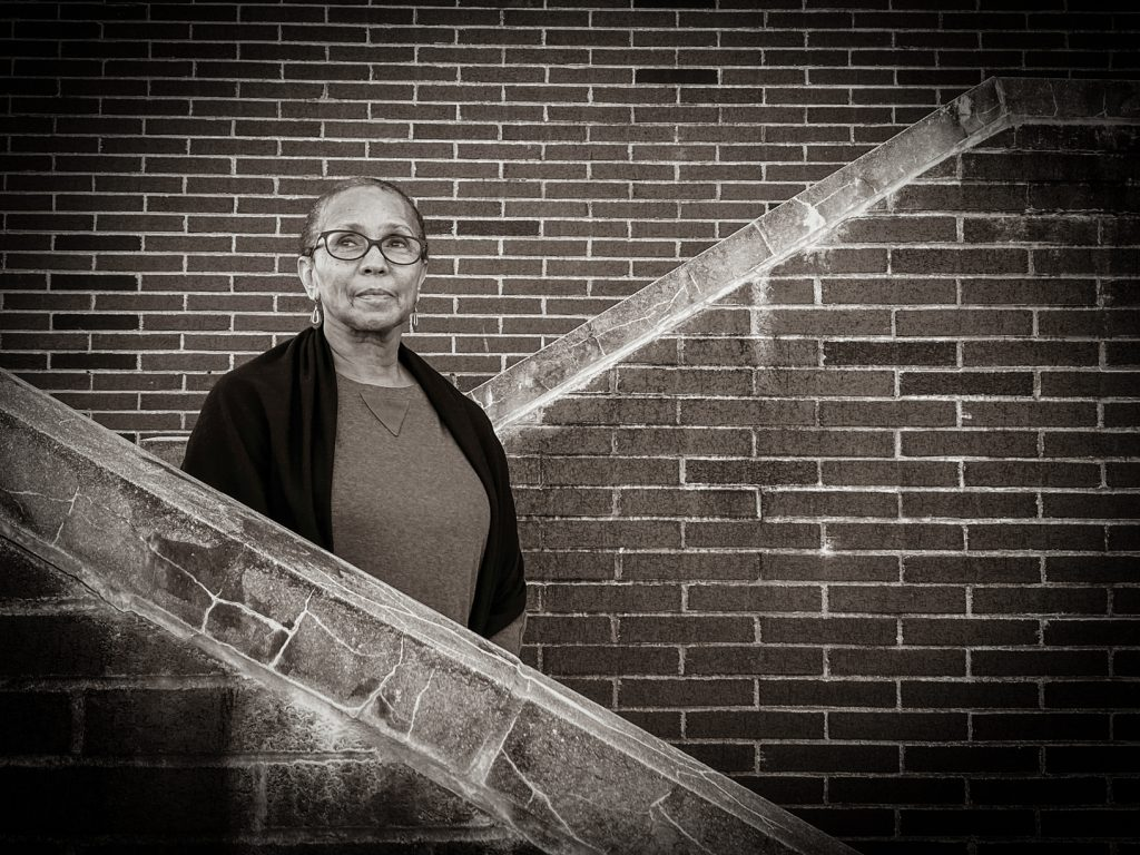 Photo of woman standing on stairs