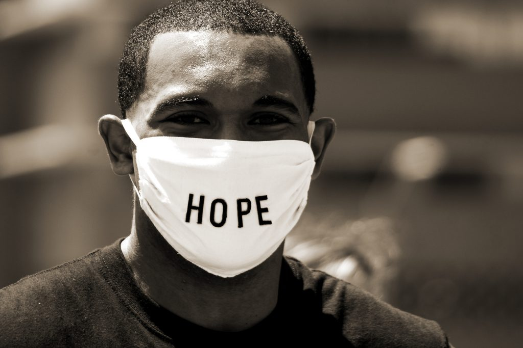 man wearing mask with hope on it