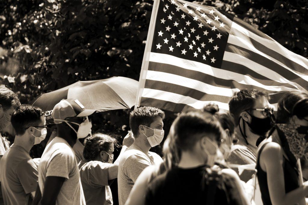 Group of people gathered with American flag