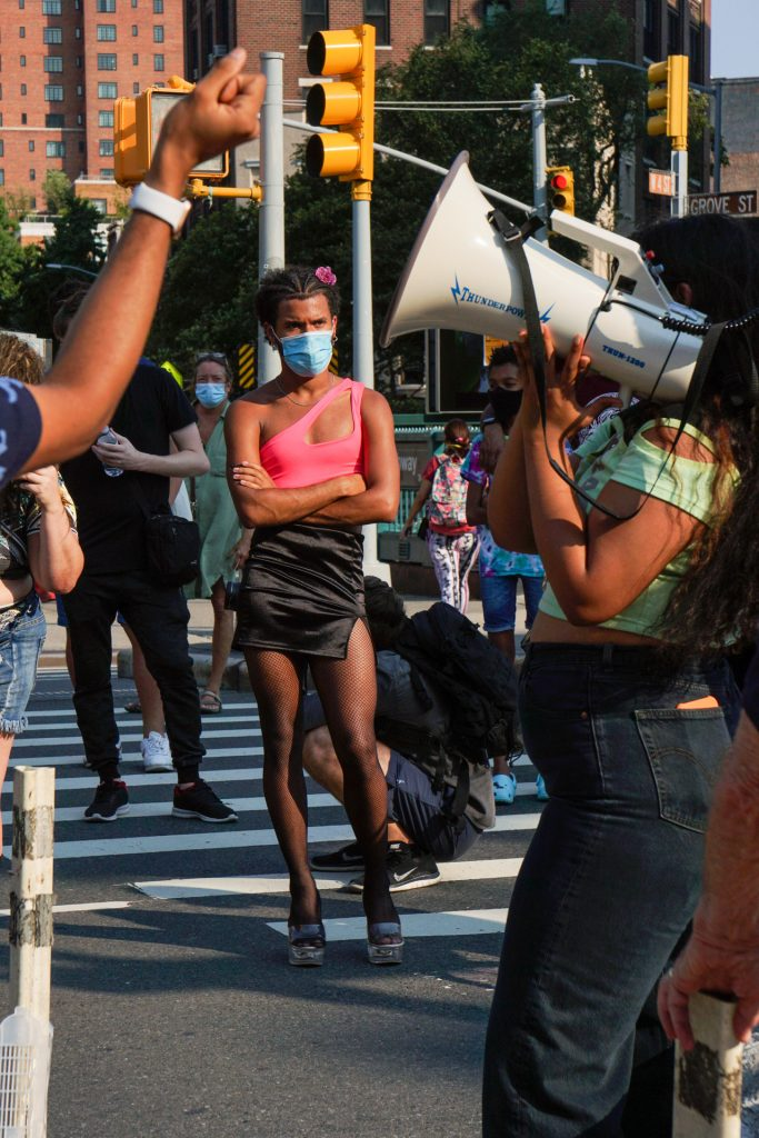 Woman looking at another woman holding bullhorn during protest