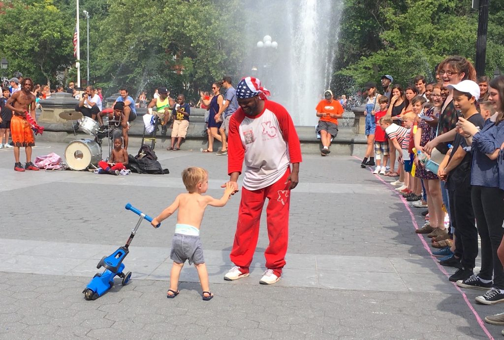 Child offering a hand to a man Black Lives Matter