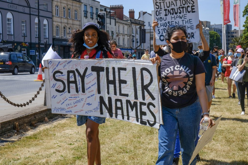 Black Lives Matter protestors march with sign placards