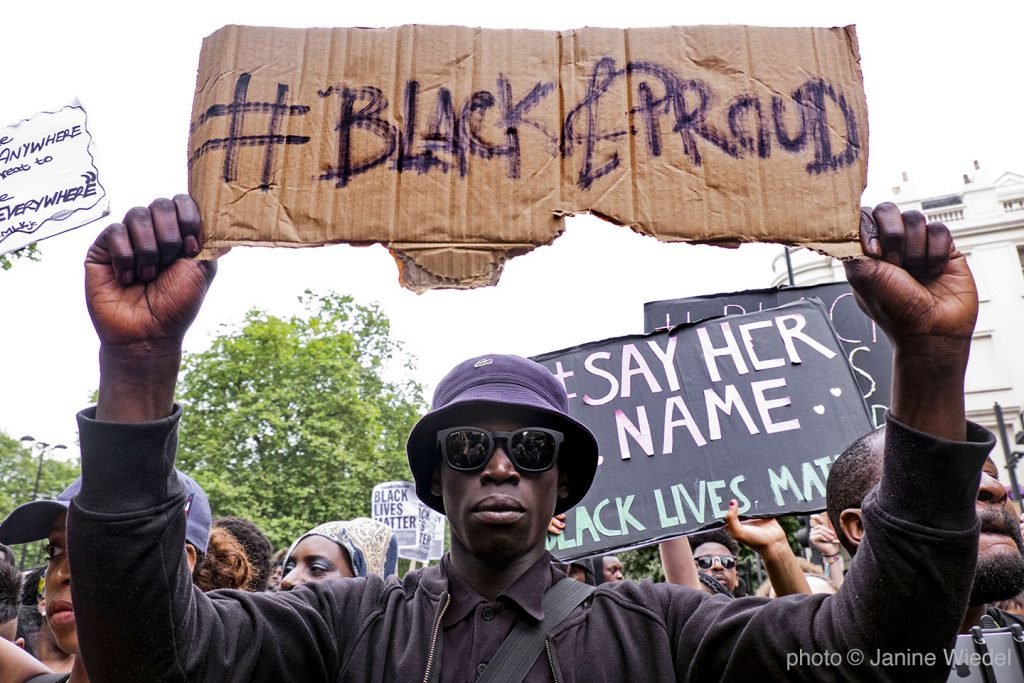 Man in London holding sign #Black and Proud